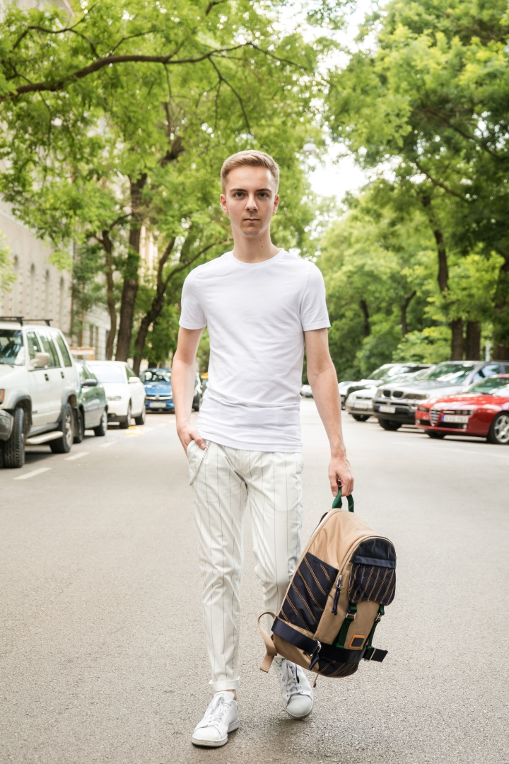 All White Outfit With Contrasting​ Beige Backpack